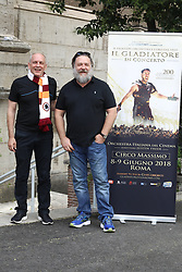 Russell Crowe and Thomas Arana are pictured wearing the scarf of the AS Roma football team during a photocall for Gladiator Live in Concert in Rome