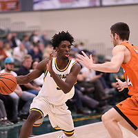 1st year guard Nigel Warden (9) of the Regina Cougars in action during the Men's Basketball Play-In game on February  8 at Centre for Kinesiology, Health and Sport. Credit: Arthur Ward/Arthur Images