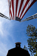 A member of Los Angeles Fire Department stands beneath a giant U.S. flag over the processional route during the funeral of Whittier Police Officer Keith Boyer at Rose Hills Memorial Park in Whittier, Calif., Friday March 3, 2017. Boyer, who was fatally shot after responding to a traffic crash, was remembered today by thousands of law enforcement officers, friends and family as a dedicated public servant, talented drummer, loving friend and even a ``goofy'' dad.(Photo by Ringo Chiu/PHOTOFORMULA.com)<br /> <br /> Usage Notes: This content is intended for editorial use only. For other uses, additional clearances may be required.