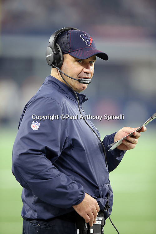Houston Texans head coach Bill O'Brien holds a play chart as he looks on from the sideline during the 2015 NFL preseason football game against the Dallas Cowboys on Thursday, Sept. 3, 2015 in Arlington, Texas. The Cowboys won the game 21-14. (©Paul Anthony Spinelli)