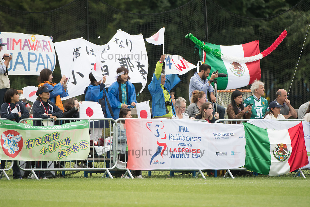 Japanese and Mexican fans wait for the game to start between their teams at the 2017 FIL Rathbones Women's Lacrosse World Cup at Surrey Sports Park, Guilford, Surrey, UK, 15th July 2017