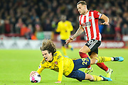 Arsenal midfielder Matteo Guendouzi (29) goes down under pressure from Sheffield United forward Billy Sharp (10)  during the Premier League match between Sheffield United and Arsenal at Bramall Lane, Sheffield, England on 21 October 2019.