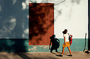 A girl returns home from school in Santiago de Cuba.