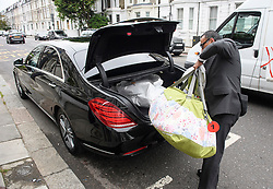 © Licensed to London News Pictures. 01/06/2016. London, UK. A mamas & papas bag carrying baby items being taken from the London home of Rolling Stones guitarist Ronnie Wood, who turned 69 today (Weds) and had twins on May 30th with his wife Sally Humphreys.  Photo credit: Ben Cawthra/LNP