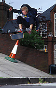Johann Carlberg doing a kick-flip on the street, UK, 2000's