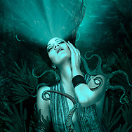 Image of a woman enraptured by a vision in a bluish underwater world