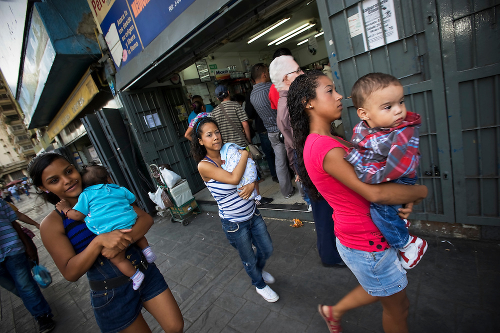 Teenage mothers, Diovile, Yanaifre and Keisy, walk with their babies to buy diapers in a slum in Caracas, Venezuela. Venezuela has the highest rate of teenage pregnancies in Latin America.  26 percent of babies are born to underage mothers.