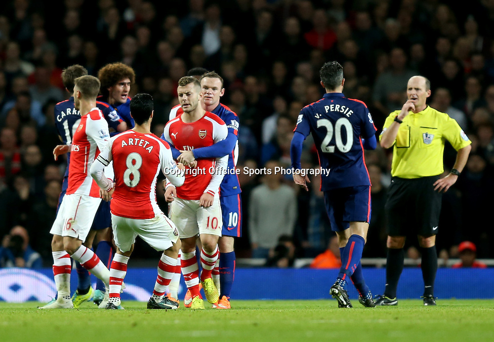 22 November 2014 - Barclays Premier League - Arsenal v Manchester United - Wayne Rooney of Manchester United restrains Tomas Rosicky of Arsenal after he clashes with Marouane Fellaini - Photo: Marc Atkins / Offside.
