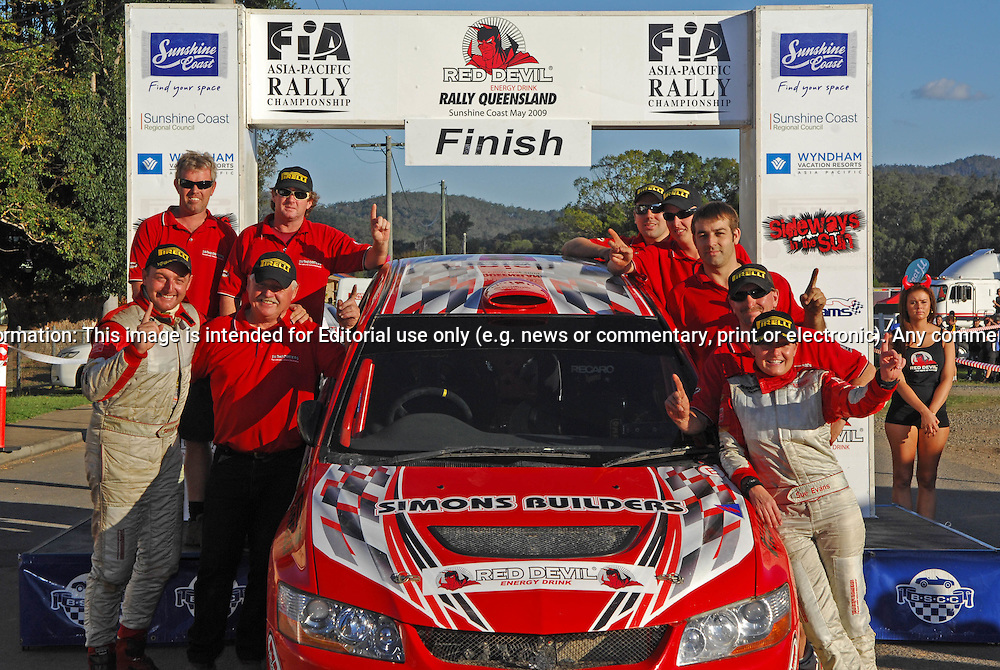 Simon & Sue Evans and Team on Podium .Heat 2.Red Devil Energy Drink Rally of Queensland.Sunshine Coast, QLD.10th of May 2009.(C) Joel Strickland Photographics.Use information: This image is intended for Editorial use only (e.g. news or commentary, print or electronic). Any commercial or promotional use requires additional clearance.