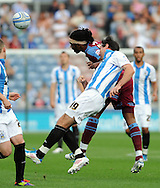 Picture by Graham Crowther/Focus Images Ltd. 07763140036.10/9/11 .Alan Lee of Huddersfield feels the tackle from Ian Goodison of Tranmere during the Npower League 1 game at the Galpharm Stadium, Huddersfield.