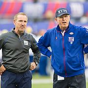 Oct 25, 2015; East Rutherford, NJ, USA; New York Giants head coach Tom Coughlin(r) speaks with coach Spagnualo during pregame at MetLife Stadium. Mandatory Credit: William Hauser-USA TODAY Sports