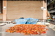 "03 DECEMBER 2012 - BANGKOK, THAILAND: Chilies dry on a food cart in ""Washington Square"" in Bangkok. Although officially closed, squatters have moved into some abandoned buildings in the area and demolition workers live in others. Washington Square was a notorious adult ""entertainment"" and red light district on Sukhumvit Soi 22 in Bangkok. Many of the bars and massage parlors catered in the district to older American and European men and opened in the 1960's when Bangkok was a ""R&R"" destination for American servicemen in Vietnam. It's being torn down to make way for new high rise hotels and condominiums.            PHOTO BY JACK KURTZ"