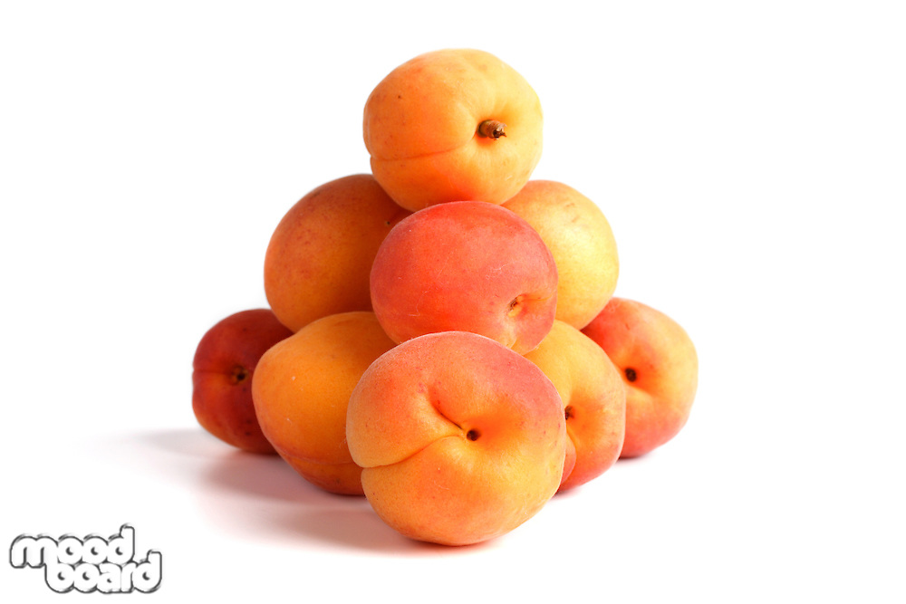 Close up of apricotes on white background