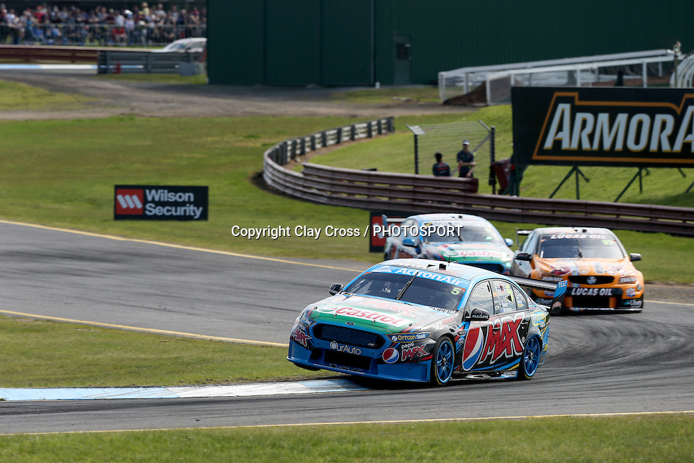 Mark Winterbottom & Steve Owen (Pepsi Max Ford) leading Shane van Gisbergen & Jonathon Webb. 2015 Wilson Security Sandown 500. V8 Supercars Championship Round 9. Sandown International Raceway, Victoria. Sunday 13 September 2015. Photo: Clay Cross / photosport.nz
