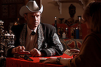 Originally shot for 002 Magazine. The goal was a cinematically themed image. The tall Western man sits in the parlor of a fortune teller. As the fortune teller reads the tarot cards, the death card is revealed. Upon her council, does the tall man reach for or remove his hand from the pistol. What paths lay ahead for the tall Western man?