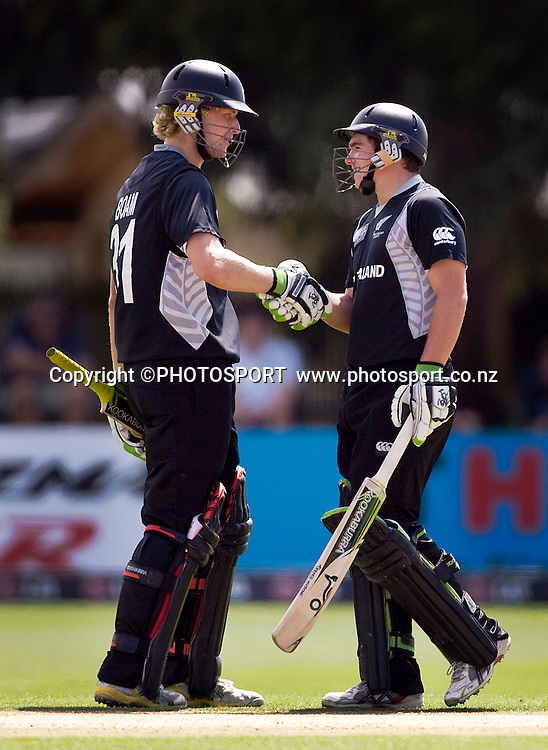 New Zealand's Tom Latham is congratulated by Harry Boam after reaching his 50. New Zealand v Zimbabwe, U19 Cricket World Cup group stage match, Bert Sutcliffe Oval, Lincoln, Tuesday 19 January 2010. Photo : Joseph Johnson/PHOTOSPORT