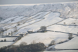&copy; Licensed to London News Pictures. <br /> 27/12/2014. <br /> <br /> Castleton, United Kingdom.<br /> <br /> Overnight snowfall covers the hills of the North Yorkshire Moors near Castleton.<br /> <br /> Photo credit : Ian Forsyth/LNP