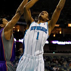 February 2, 2012; New Orleans, LA, USA; New Orleans Hornets small forward Trevor Ariza (1) shoots over Phoenix Suns center Channing Frye (8) during the first quarter of a game at the New Orleans Arena.   Mandatory Credit: Derick E. Hingle-US PRESSWIRE