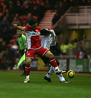 Photo: Andrew Unwin.<br /> Middlesbrough v Fulham. The Barclays Premiership.<br /> 20/11/2005.<br /> Middlesbrough's Fabio Rochemback (L) clatters into Fulham's Papa Bouba Diop (R).