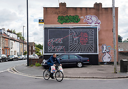 © Licensed to London News Pictures; 10/07/2020; Bristol, UK. A mural depicting the fall of slavetrader Edward Colston's statue and the continuing fight for justice is seen installed on a billboard in Easton. The artwork is by RTiiiKA, a Bristol-based illustrator and co-founder of the Bristol Womxn Mural Collective, who drew the work the same day Colston's statue was toppled from its plinth, dragged through the city centre and thrown into Bristol Harbour during a Black Lives Matter protest rally and march on 07 June in memory of George Floyd, a black man who was killed on May 25, 2020 in Minneapolis in the US by a white police officer kneeling on his neck for nearly 9 minutes. The killing of George Floyd has seen widespread protests in the US, the UK and other countries. RTiiiKA and Bristol Rising Tide, a direct action group collaborated to reclaim the billboard space, which is used by corporate advertising. RTiiiKA has said that the artwork is political both in its documentation of the statue's fall and taking over advertising space, and in calling for continued anti-racist activism.<br /> The red rope is to illustrate that the violent oppression and racism that Colston and Bristol profited from centuries ago is still tangled to racism today and that the rope winding around the people in the crowd is also a call to RTiiiKA as a white person to recognise and untangle prejudices, privilege and position. RTiiiKA calls on white people to keep a grip on the rope and continue to fight against their biases and subconscious discrimination against black people. Photo credit: Simon Chapman/LNP.
