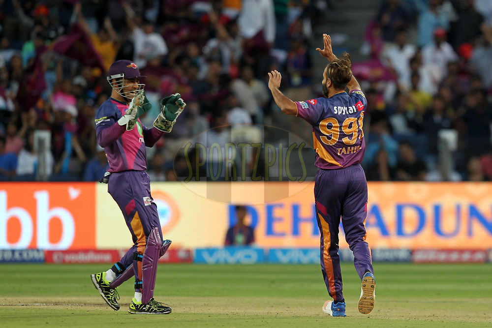 Mahendar Singh Dhoni and Imran Tahir of Rising Pune Supergiants celebrates wicket of Pawan Negi of  Royal Challengers Bangalore during match 34 of the Vivo 2017 Indian Premier League between the Rising Pune Supergiants and the Royal Challengers Bangalore   held at the MCA Pune International Cricket Stadium in Pune, India on the 29th April 2017Photo by Prashant Bhoot - Sportzpics - IPL
