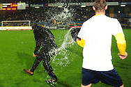 Ruud Brood is thrown with water after the game by Braber