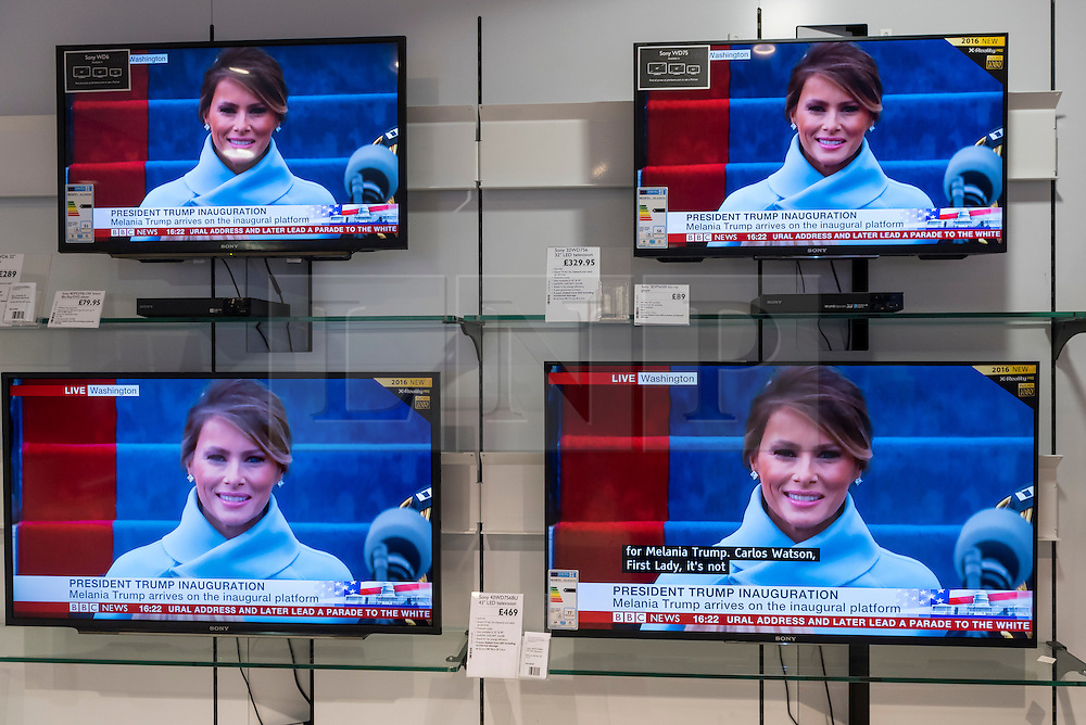 © Licensed to London News Pictures. 20/01/2017. London, UK. Milania Trump is seen on multiple TV screens in a department store showing the live broadcast of the inauguration of Donald Trump as U.S. President. Photo credit : Stephen Chung/LNP