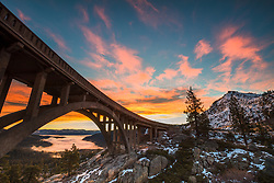"""Sunrise at Rainbow Bridge 3"" - Photograph of a vibrant sunrise at Rainbow Bridge above Truckee and Donner Lake (under the fog)."