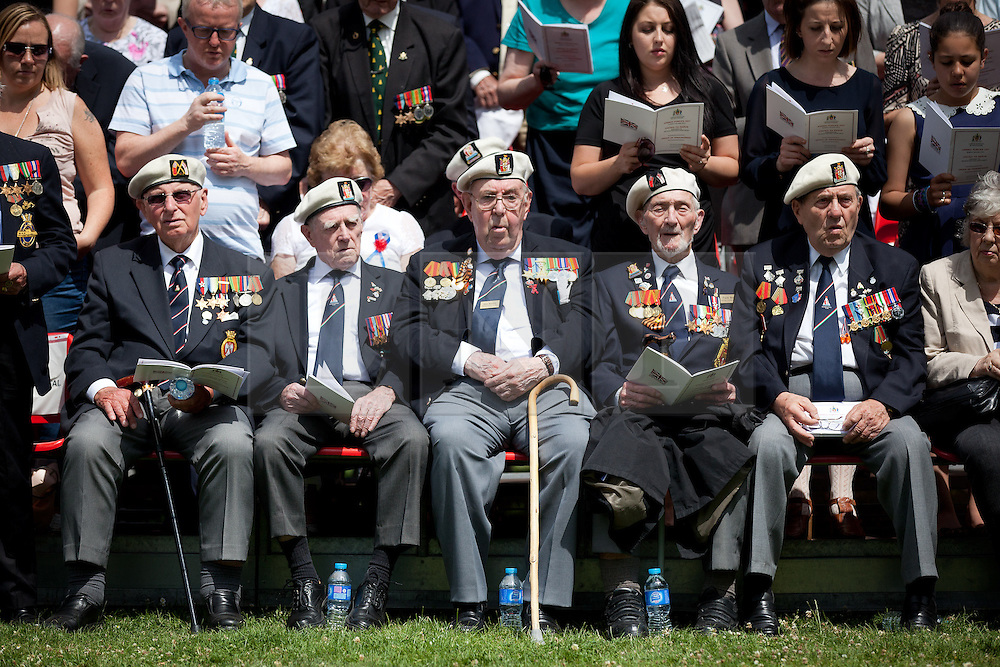 © Licensed to London News Pictures. 30/06/2013. London, UK. World War Two Veterans of the arctic convoys sit and watch Territorial Army soldiers and cadets parade in Southwark, London, today (30/06/2013) as part of Armed Forces Day celebrations held across the country during the weekend. . Units, including City of London Field Hospital Volunteers, The Royal Marines Reserve (City of London), RMR London, The London Irish Rifles: 'D' Company and The London Regiment, all units with connections to the Southwark, were today presented with the freedom of the borough as part of Armed Forces Day celebrations. Photo credit: Matt Cetti-Roberts/LNP