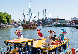 "© Licensed to London News Pictures.  27/06/2018; Bristol, UK. Gromit Unleashed 2, official launch at Bristol Harbourside, with the ship ""The Matthew"" in the background. Gromit Unleashed 2 will see the Academy Award®-winning character Gromit by Nick Park at Aardman Animations returning to Bristol in 2018 for the second time on sculpture trails to raise money for  the Grand Appeal charity. The character of Gromit will be joined by Wallace and arch nemesis Feathers McGraw.<br /> The trail will feature over 60 giant sculptures, including a new WG Grace cricketing Gromit, designed by high-profile artists, designers, innovators and local talent. Sculptures will be positioned in high footfall and iconic locations around Bristol and the surrounding area, for a family day out around the city and beyond. Photo credit: Simon Chapman/LNP"