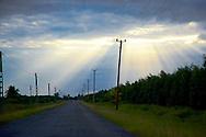 Evening road and sun rays near Manuel Lazo, Pinar del Rio, Cuba.