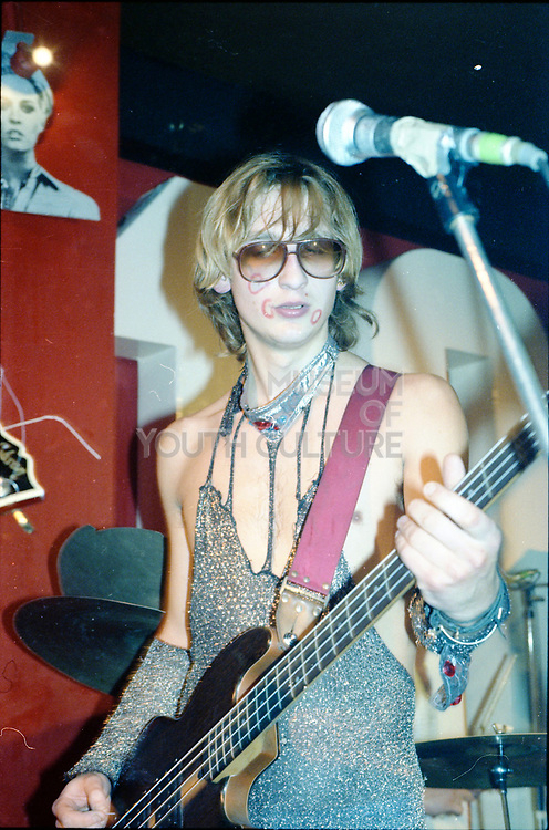 Trapper playing bass with Peter and the Test Tube Babies at the 100 Club, London, UK, 1980s