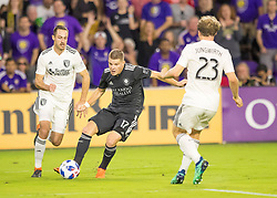 April 21, 2018 - Orlando, FL, U.S. - ORLANDO, FL - APRIL 21: Orlando City forward Chris Mueller (17) looks to pass during the MLS soccer match between the Orlando City FC and the San Jose Earthquakes at Orlando City SC on April 21, 2018 at Orlando City Stadium in Orlando, FL. (Photo by Andrew Bershaw/Icon Sportswire) (Credit Image: © Andrew Bershaw/Icon SMI via ZUMA Press)