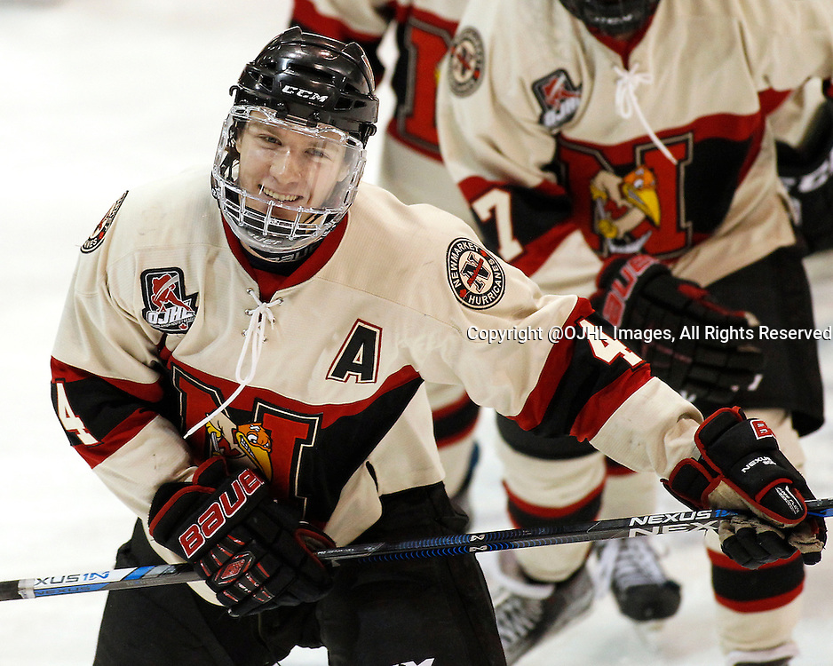 NEWMARKET, ON - Dec 3, 2015 : Ontario Junior Hockey League game action between Milton and Newmarket, Adam Smith #4 celebrates the goal during the second period.<br /> (Photo by Brian Watts / OJHL Images)
