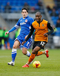 Benik Afobe of Wolverhampton Wanderers is challenged by Peter Whittingham of Cardiff City - Photo mandatory by-line: Rogan Thomson/JMP - 07966 386802 - 28/02/2015 - SPORT - FOOTBALL - Cardiff, Wales - Cardiff City Stadium - Cardiff City v Wolverhampton Wanderers - Sky Bet Championship.