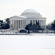 The Jefferson Memorial after a snow storm, with the Tidal Basin frozen over.