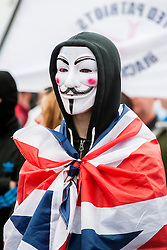 "Rotherham England<br /> 13 September 2014 <br /> Protestors wearing Anonymous mask and Union Flag outside Rotherham Town Hall before the start of the English Defence Leagues Justice for the Rotherham 1400 March on Saturday Afternoon described by an EDL Facebook Page as ""a protest against the Pakistani Muslim grooming gangs"" on Saturday Afternoon <br /> <br /> <br /> Image © Paul David Drabble <br /> www.pauldaviddrabble.co.uk"