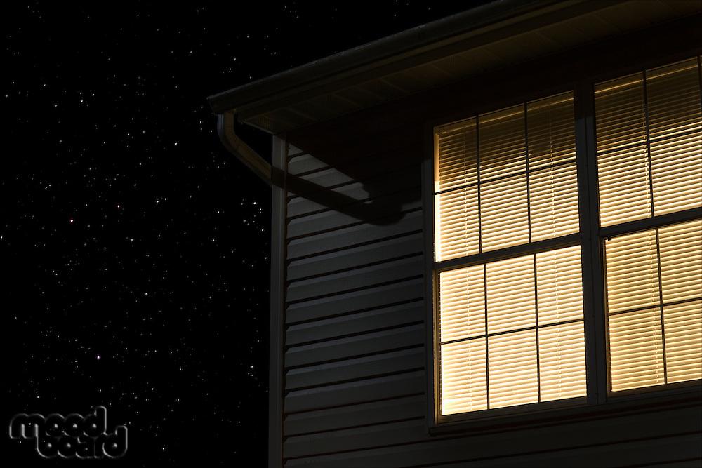 Lit window of building exterior