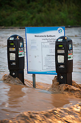© Licensed to London News Pictures. 06/09/2013<br /> <br /> Saltburn, Cleveland, England<br /> <br /> As darkness falls heavy flooding washes over an area known as the Cat Nab car park area in Saltburn in Cleveland. <br /> <br /> Photo credit : Ian Forsyth/LNP