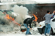 PRICE CHAMBERS/JACKSON HOLE DAILY<br /> Armed with a shovel, Carlos Chavez, right, rushes to throw snow on his vehicle as it's engulfed in flame on Thursday at his home at 1175 Gregory Ln. &quot;All I saw was smoke coming out from under the hood,&quot; Chavez said. &quot;I honestly couldn't tell you what happened.&quot; Chavez's neighbors helped by throwing more snow on the blaze until Jackson Hole Fire/EMS could respond.