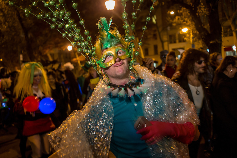 New York, NY - 31 October 2015. A man  in a bubble-wrap cape, a fiber-optic collar, and sparkles, in the Greenwich Village Halloween Parade.