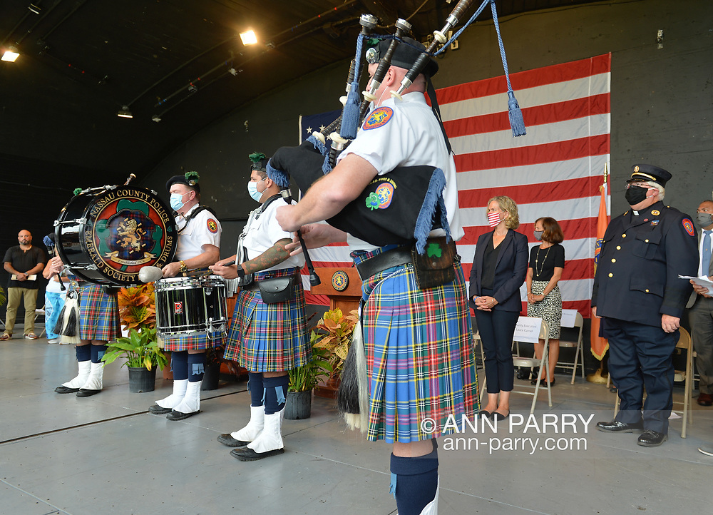 East Meadow, New York, U.S. September 10, 2020. Nassau County Police Emerald Society Pipes & Drums band performs during the county's commemoration of 19th anniversary of September 11 terrorist attacks with Remembrance Ceremony at Eisenhower Park. County Executive LAURA CURRAN, wearing black and standing by flag, wore a face mask, as did all others when social distancing wasn't possible. Event was held at Harry Chapin Lakeside Theater, instead of 9/11 Memorial across the pond, because of rain prediction.