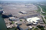 Nederland, Amsterdam, Westhaven, 17/05/2002; Westelijke havengebied - Jan Riebeeckhaven met de terminal van NIssan en terrrein voor geimporteerde auoto's; in de voorgrond Cornelder: terminal voor overslag naar binnenvaartschepen; scheepvaart economie bedrijvigheid industrie;<br /> luchtfoto (toeslag), aerial photo (additional fee)<br /> foto /photo Siebe Swart