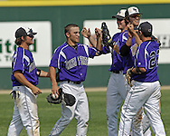The Kansas State Wildcats congratulate center fielder Tyler Link (C) after making the final out, as the Wildcats held on to beat Kansas 5-4 at Tointon Stadium in Manhattan, Kansas, April 23, 2006.