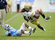 Atlanta - Georgia Tech's Anthony Allen (18) hangs in the air after being hit by the  University  of North Carolina's Charles Brown  at  Bobby Dodd Stadium at Historic Grant Field on Saturday, September 26, 2009.  Tech won the game 24 to 7. 2009 © Johnny Crawford