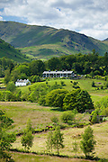 Cottages in Langdale Pass surrounded by Langdale Pikes in the Lake District National Park, Cumbria, UK