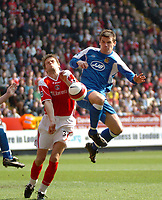 Photo: Tony Oudot.<br />Charlton Athletic v Wigan Athletic. The Barclays Premiership. 31/03/2007.<br />Lee McCulloch has a shot on goal challenged by Hermann Hreidarsson of Charlton