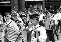 Twelfth, Belfast, N Ireland, 12th July 1969 - accordian band leads Orangemen in Belfast City Centre on their way to The Field, Finaghy, South Belfast, N Ireland. 196907120189b<br />