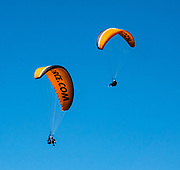 Tandem paragliding over Queenstown, Otago region, South Island of New Zealand. Queenstown Bay is on Lake Wakatipu, a long Z-shaped lake carved by glaciers.