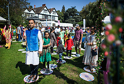 © Licensed to London News Pictures. 02/09/2018. Aldenham, UK. Followers of Hare Krishna branch of Hinduism walk the 108 steps to enlightenment at Bhaktivedanta Manor, Hare Krishna Temple in Aldenham, Hertfordshire during celebrations for the Janmashtami festival. Janmashtami is an annual Hindu festival that celebrates the birth of Krishna. Bhaktivedanta Manor, the venue fo the event, was donated to the Hare Krishna movement in February 1973 by former Beatle George Harrison. Photo credit: Ben Cawthra/LNP